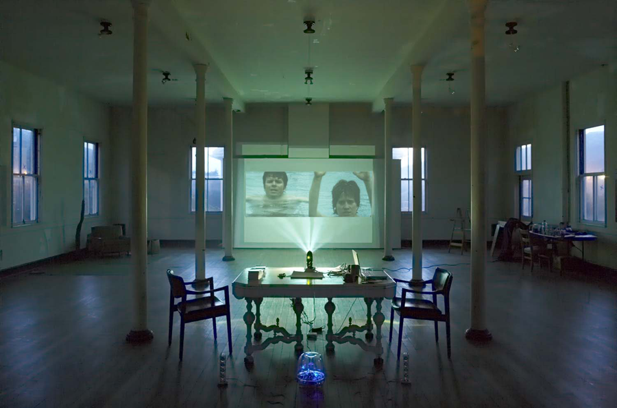 How Great Thou Art, Installation view: Project Space, Headlands Center for the Arts, California, 2006 (Photo Credit: Jeffery Cross); Single- or two-channel projection with sound, 2005, TRT: 2 min (Swimmers: Frank Ham, Mel Day)